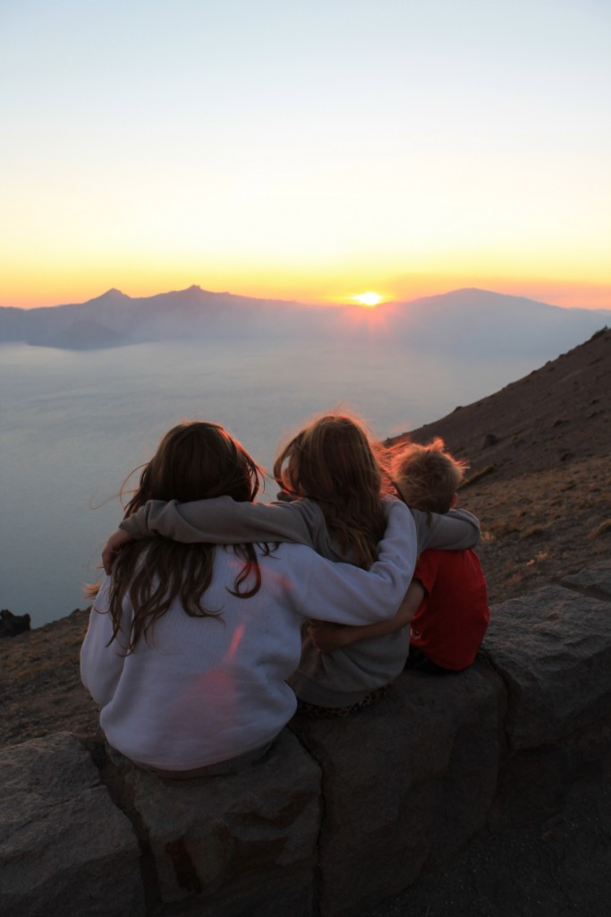 The Siblings Hugging While Gazing at the Sunset Shot
